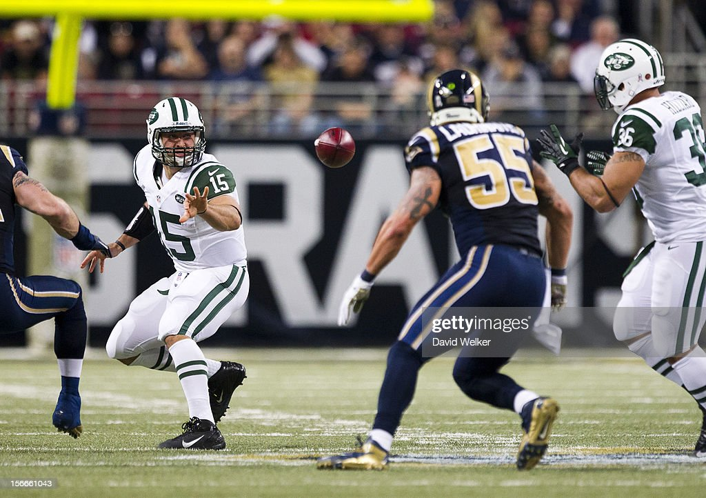 Quarterback <a gi-track='captionPersonalityLinkClicked' href=/galleries/search?phrase=Tim+Tebow&family=editorial&specificpeople=2729658 ng-click='$event.stopPropagation()'>Tim Tebow</a> #15 of the New York Jets flips the ball to fullback Lex Hilliard #36 of the New York Jets during the game against the St. Louis Rams at the Edward Jones Dome on November 18, 2012 in St. Louis, Missouri.