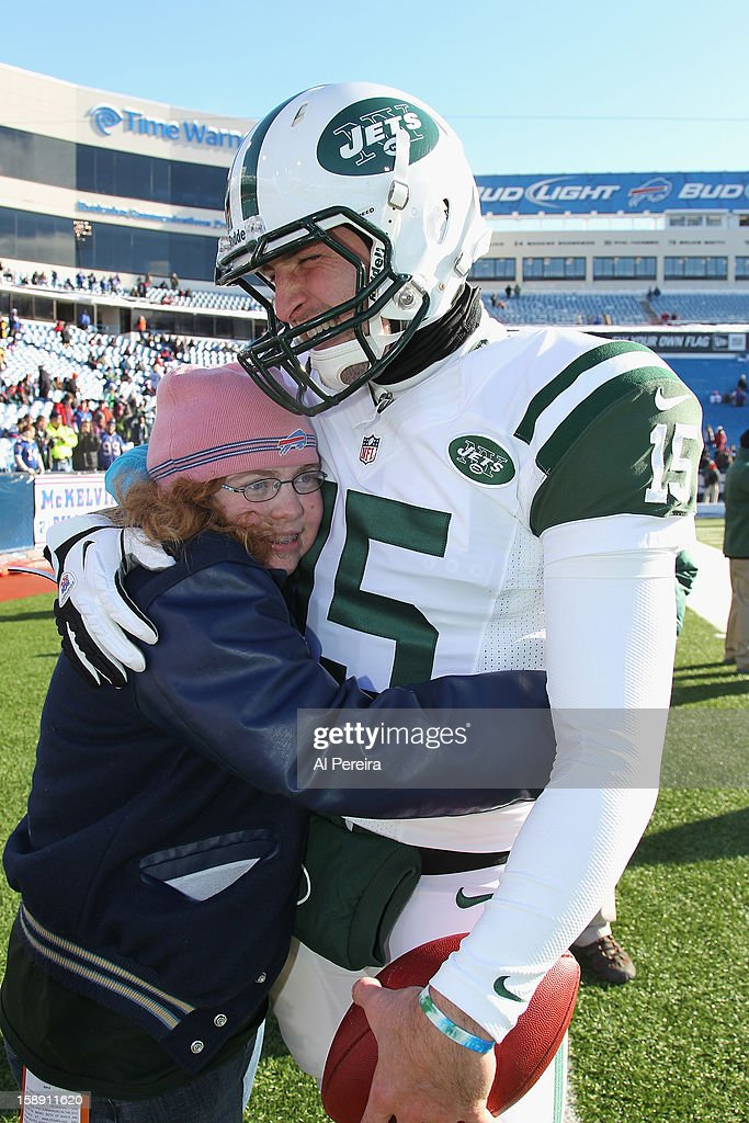 Quarterback Tim Tebow #15 of the New York Jets meets with his W15h Foundation guest before the game against the Buffalo Bills when the Buffalo Bills host the New York Jets at Ralph Wilson Stadium on December 30, 2012 in Orchard Park, New York.
