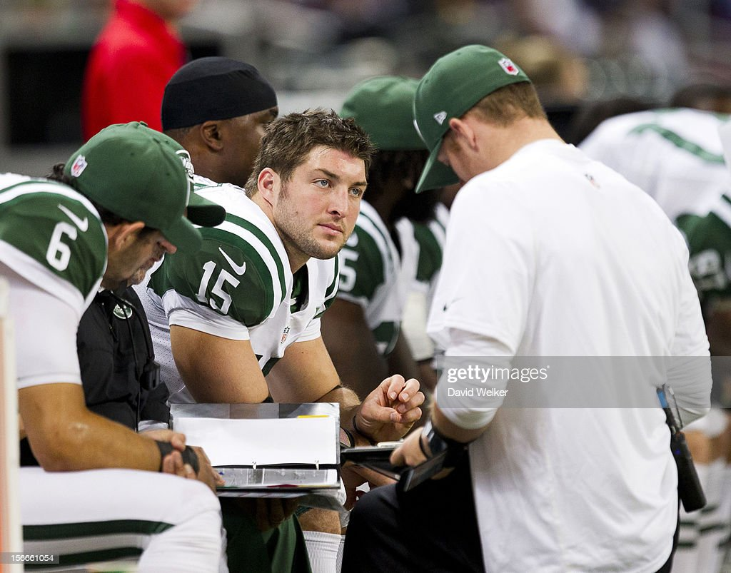 Quarterback <a gi-track='captionPersonalityLinkClicked' href=/galleries/search?phrase=Tim+Tebow&family=editorial&specificpeople=2729658 ng-click='$event.stopPropagation()'>Tim Tebow</a> #15 of the New York Jets sits on the bench during the game against the St. Louis Rams at the Edward Jones Dome on November 18, 2012 in St. Louis, Missouri.