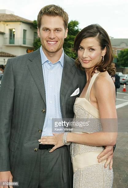 NFL quarterback Tom Brady and actress Bridget Moynahan attend the premiere of 20th Century Fox's 'I Robot' at the Village Theater on July 7 2004 in...