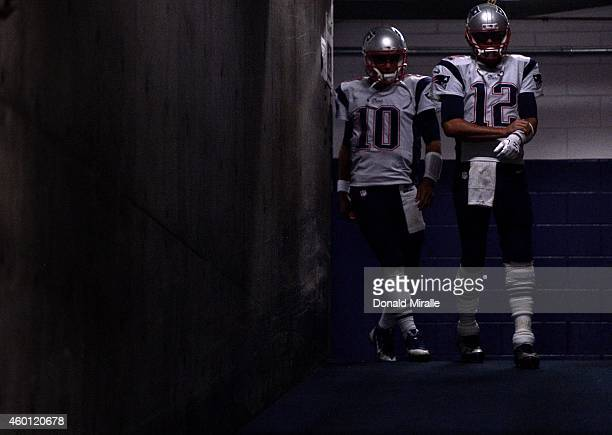 Quarterback Tom Brady and Jimmy Garoppolo of the New England Patriots head to the field against the San Diego Chargers during their NFL Game at...