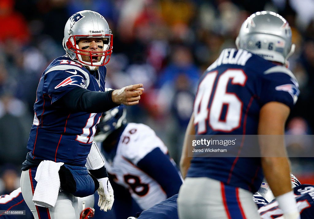 Quarterback <a gi-track='captionPersonalityLinkClicked' href=/galleries/search?phrase=Tom+Brady+-+American+Football+Quarterback&family=editorial&specificpeople=201737 ng-click='$event.stopPropagation()'>Tom Brady</a> #12 of the New England Patriots calls a play against the Denver Broncos during a game at Gillette Stadium on November 24, 2013 in Foxboro, Massachusetts.