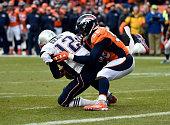 Quarterback Tom Brady of the New England Patriots gets sacked by outside linebacker Von Miller of the Denver Broncos in the third quarter The Denver...