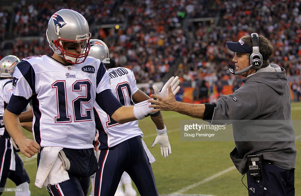 Quarterback <a gi-track='captionPersonalityLinkClicked' href=/galleries/search?phrase=Tom+Brady+-+American+Football+Quarterback&family=editorial&specificpeople=201737 ng-click='$event.stopPropagation()'>Tom Brady</a> #12 of the New England Patriots high-fives Head Coach <a gi-track='captionPersonalityLinkClicked' href=/galleries/search?phrase=Bill+Belichick&family=editorial&specificpeople=201822 ng-click='$event.stopPropagation()'>Bill Belichick</a> after scoring touchdown in the third quarter against the Denver Broncos at Sports Authority Field at Mile High on December 18, 2011 in Denver, Colorado.
