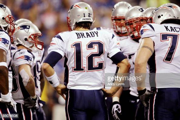 Quarterback Tom Brady of the New England Patriots huddles up his team during the third quarter of the game against the Indianapolis Colts at Lucas...
