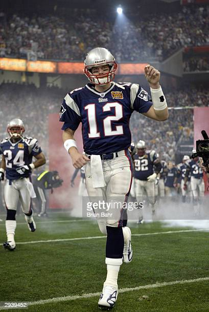 Quarterback Tom Brady of the New England Patriots is introduced to the fans before Super Bowl XXXVIII against the Carolina Panthers at Reliant...