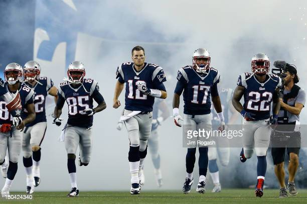 Quarterback Tom Brady of the New England Patriots leads the team onto the field before taking on the New York Jets at Gillette Stadium on September...