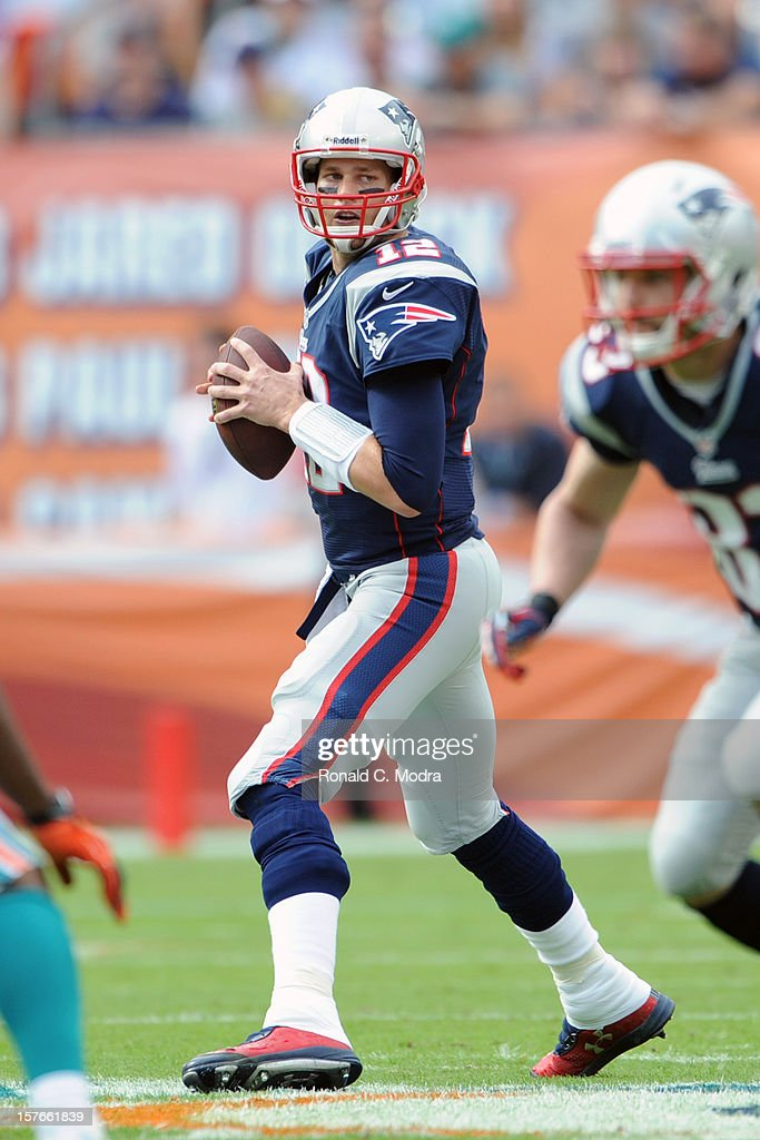 Quarterback <a gi-track='captionPersonalityLinkClicked' href=/galleries/search?phrase=Tom+Brady+-+American+football-quarterback&family=editorial&specificpeople=201737 ng-click='$event.stopPropagation()'>Tom Brady</a> #12 of the New England Patriots looks for a receiver during a NFL game against the Miami Dolphins at Sun Life Stadium on December 2, 2012 in Miami Gardens, Florida.