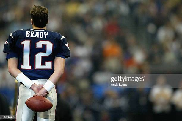 Quarterback Tom Brady of the New England Patriots looks on before Super Bowl XXXVIII against the Carolina Panthers at Reliant Stadium on February 1...