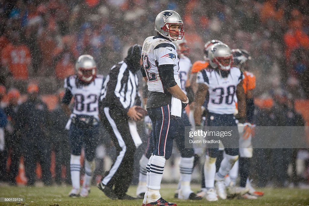Quarterback <a gi-track='captionPersonalityLinkClicked' href=/galleries/search?phrase=Tom+Brady+-+American+Football+Quarterback&family=editorial&specificpeople=201737 ng-click='$event.stopPropagation()'>Tom Brady</a> #12 of the New England Patriots looks to the sideline during a game against the Denver Broncos at Sports Authority Field at Mile High on November 29, 2015 in Denver, Colorado. The Broncos beat the Patriots 30-24 in overtime.