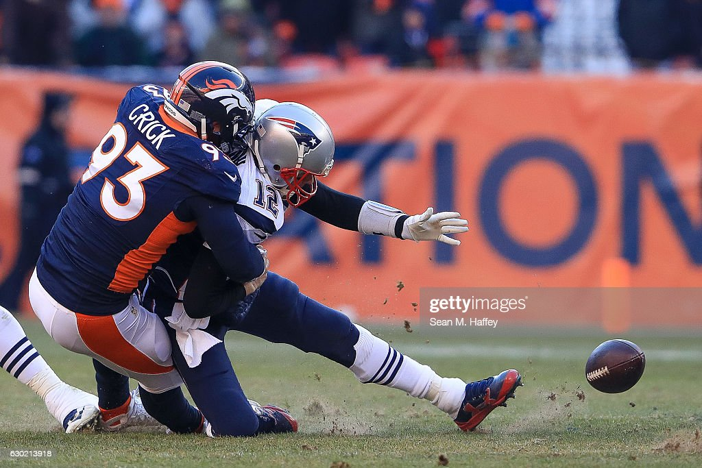 Quarterback Tom Brady #12 of the New England Patriots loses the ball as he is sacked by defensive end Jared Crick #93 of the Denver Broncos in the second quarter at Sports Authority Field at Mile High on December 18, 2016 in Denver, Colorado.