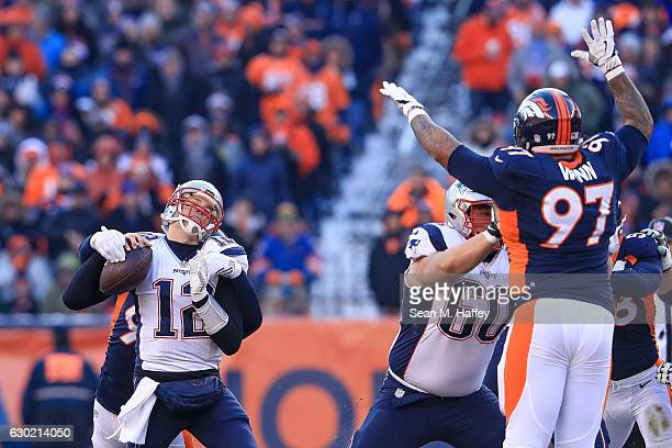 Quarterback Tom Brady of the New England Patriots loses the ball as he is sacked by defensive end Jared Crick of the Denver Broncos in the second...