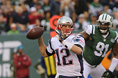 Quarterback Tom Brady of the New England Patriots passes the ball against the New York Jets at MetLife Stadium on December 27 2015 in East Rutherford...