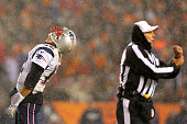 Quarterback Tom Brady of the New England Patriots reacts to a holding call by the referee in the fourth quarter at Sports Authority Field at Mile...