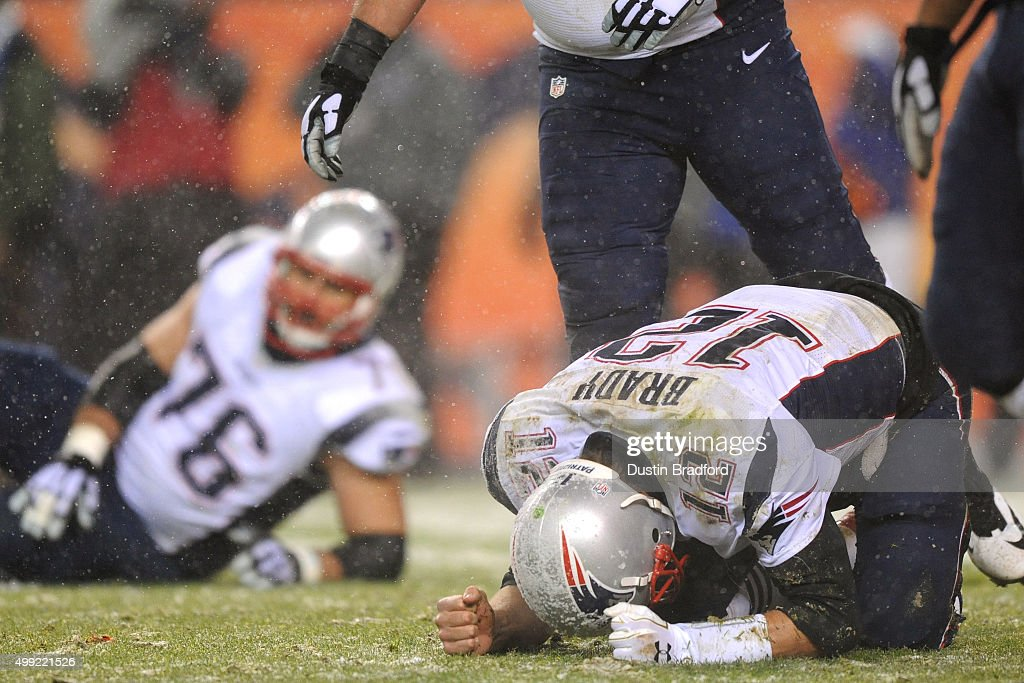 Quarterback Tom Brady of the New England Patriots reacts to a play against the Denver Broncos in the fourth quarter at Sports Authority Field at Mile...