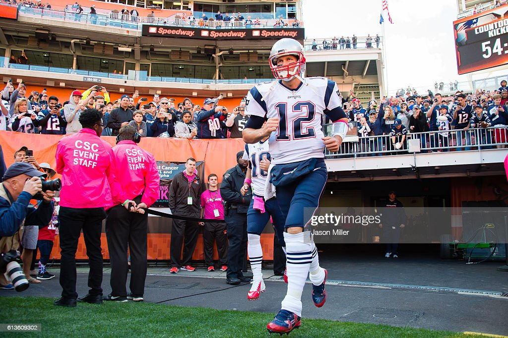 Quarterback Tom Brady of the New England Patriots runs onto the field prior to the game against the Cleveland Browns at FirstEnergy Stadium on...