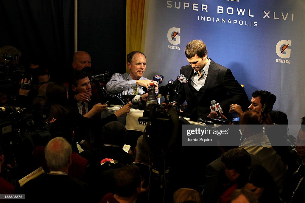 Quarterback <a gi-track='captionPersonalityLinkClicked' href=/galleries/search?phrase=Tom+Brady+-+American+Football+Quarterback&family=editorial&specificpeople=201737 ng-click='$event.stopPropagation()'>Tom Brady</a> #12 of the New England Patriots speaks to the media after losing to the New York Giants in Super Bowl XLVI at Lucas Oil Stadium on February 5, 2012 in Indianapolis, Indiana. The New York Giants defeated the New England Patriots 21-17.