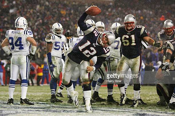 Quarterback Tom Brady of the New England Patriots spikes the ball after scoring a touchdown against the Indianapolis Colts during the AFC divisional...
