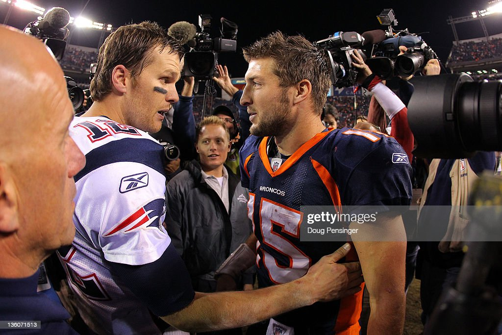 Quarterback <a gi-track='captionPersonalityLinkClicked' href=/galleries/search?phrase=Tom+Brady+-+American+Football+Quarterback&family=editorial&specificpeople=201737 ng-click='$event.stopPropagation()'>Tom Brady</a> #12 of the New England Patriots talks with quarterback <a gi-track='captionPersonalityLinkClicked' href=/galleries/search?phrase=Tim+Tebow&family=editorial&specificpeople=2729658 ng-click='$event.stopPropagation()'>Tim Tebow</a> #15 of the Denver Broncos after the game at Sports Authority Field at Mile High on December 18, 2011 in Denver, Colorado. The Patriots defeated the Broncos 41-23.
