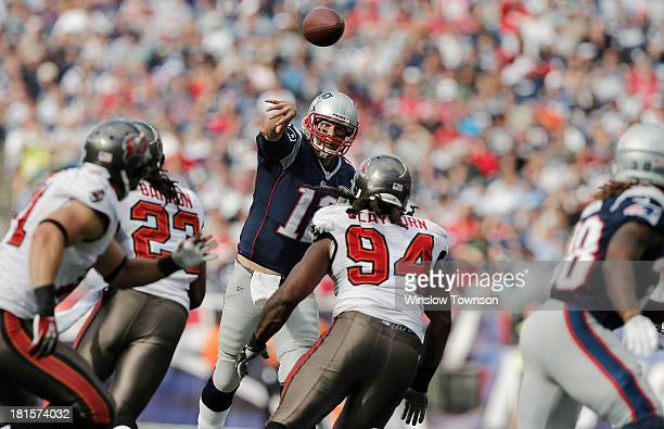 Quarterback Tom Brady of the New England Patriots throws downfield over Adrian Clayborn of the Tampa Bay Buccaneers during the second half of their...