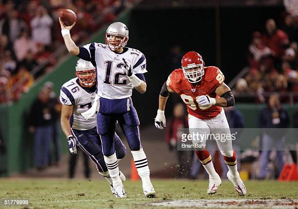 Quarterback Tom Brady of the New England Patriots throws the ball for a 42yard gain under pressure from defensive end Eric Hicks of the Kansas City...