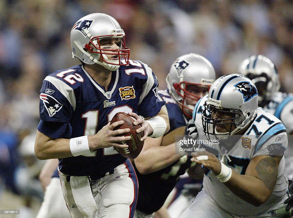 Quarterback Tom Brady #12 of the New England Patriots with the ball against the Carolina Panthers during Super Bowl XXXVIII at Reliant Stadium on February 1, 2004 in Houston, Texas. The Patriots won 32-29 to claim their second Super Bowl in three years.