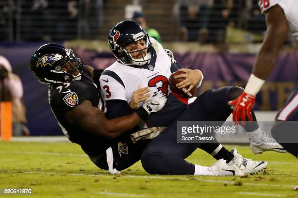 Quarterback Tom Savage of the Houston Texans is sacked by outside linebacker Terrell Suggs of the Baltimore Ravens in the second quarter at MT Bank...