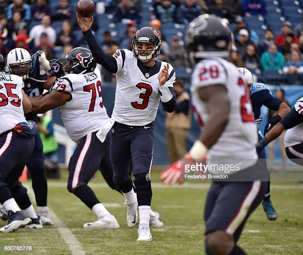 Quarterback Tom Savage of the Houston Texans throws a pass against the Tennessee Titans during the first half at Nissan Stadium on January 1 2017 in...