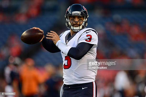 Quarterback Tom Savage of the Houston Texans warms up before a game against the Denver Broncos at Sports Authority Field at Mile High on October 24...