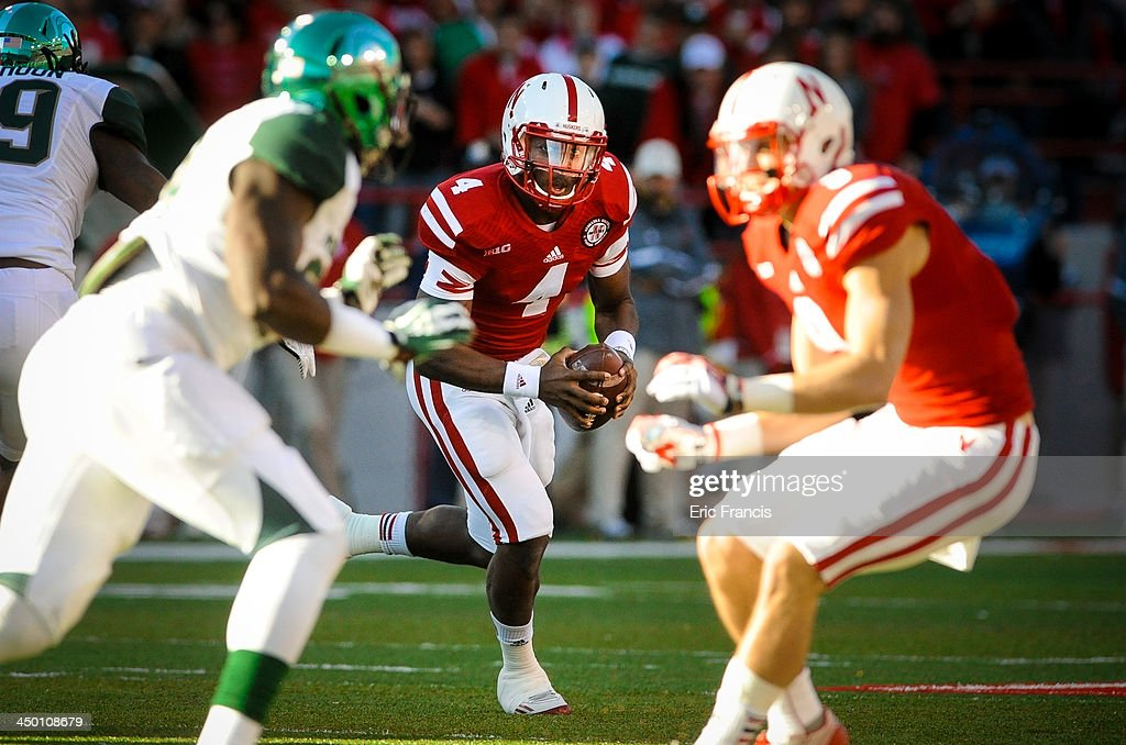 Quarterback Tommy Armstrong Jr. #4 of the Nebraska Cornhuskers looks for an opening in the Michigan State Spartans during their game at Memorial Stadium on November 16, 2013 in Lincoln, Nebraska.
