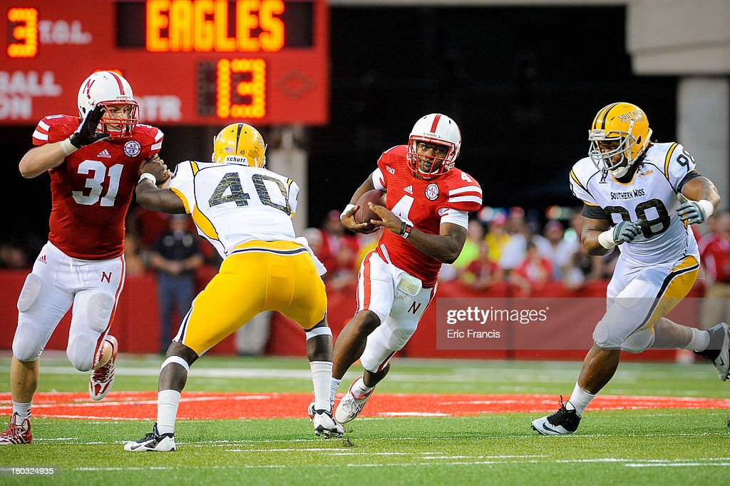 Quarterback Tommy Armstrong Jr. #4 of the Nebraska Cornhuskers runs the ball during their game against the Southern Miss Golden Eagles at Memorial Stadium on September 7, 2013 in Lincoln, Nebraska. Nebraska defeated Southern Miss 56-13.