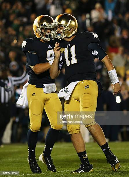 Quarterback Tommy Rees and wide receiver Robby Toma of the Notre Dame Fighting Irish celebrate in the second quarter against the Michigan Wolverines...