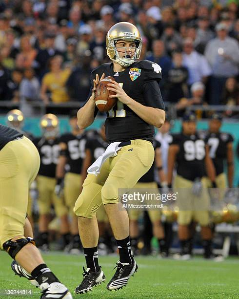 Quarterback Tommy Rees of the Notre Dame Fight Irish sets to pass against the Florida State Seminoles in the Champs Sports Bowl December 29 2011 at...