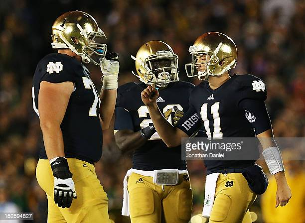 Quarterback Tommy Rees of the Notre Dame Fighting Irish celebrates with teammates guard Christian Lombard against the Notre Dame Fighting Irish...