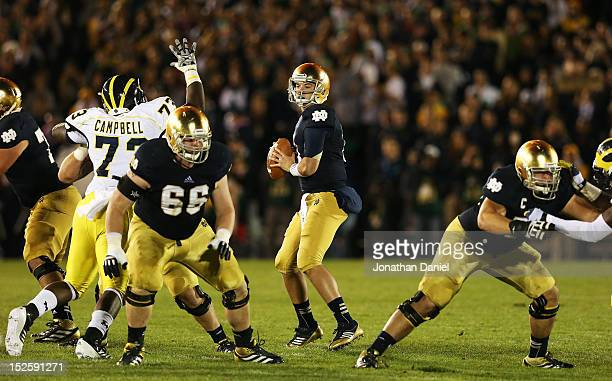 Quarterback Tommy Rees of the Notre Dame Fighting Irish looks to pass against the Michigan Wolverines in the second quarter at Notre Dame Stadium on...