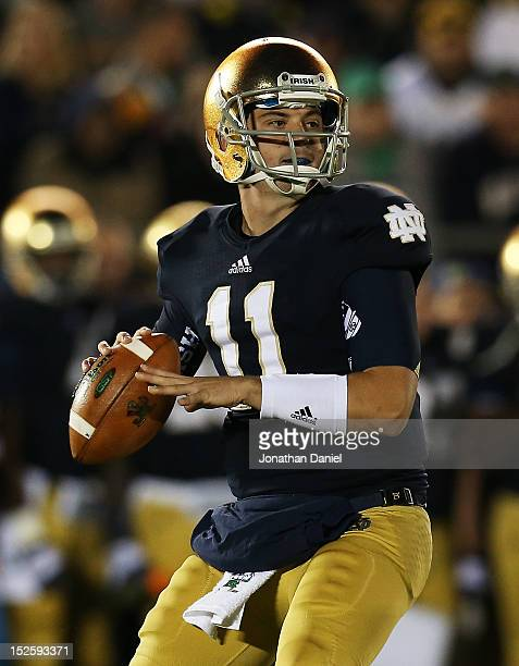 Quarterback Tommy Rees of the Notre Dame Fighting Irish looks to pass against the Michigan Wolverines in the third quarter at Notre Dame Stadium on...