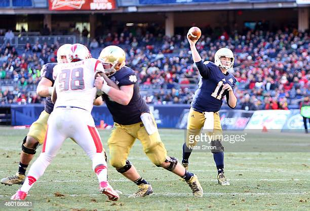 Quarterback Tommy Rees of the Notre Dame Fighting Irish throws the ball against the Rutgers Scarlet Knights during the New Era Pinstripe Bowl at...