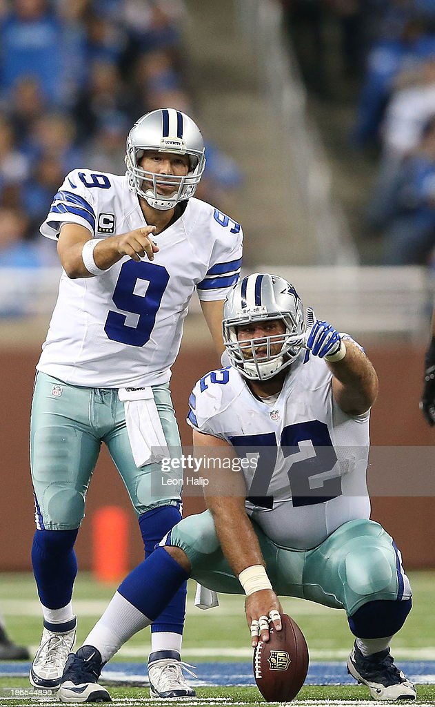 Quarterback <a gi-track='captionPersonalityLinkClicked' href=/galleries/search?phrase=Tony+Romo&family=editorial&specificpeople=756503 ng-click='$event.stopPropagation()'>Tony Romo</a> #9 and <a gi-track='captionPersonalityLinkClicked' href=/galleries/search?phrase=Travis+Frederick&family=editorial&specificpeople=6243538 ng-click='$event.stopPropagation()'>Travis Frederick</a> #72 of the Dallas Cowboys call of the play during the first quarter of the game against the Detroit Lions at Ford Field on October 27, 2013 in Detroit, Michigan. The Lions defeated the Cowboys 31-30.