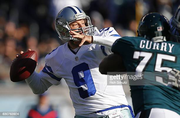 Quarterback Tony Romo of the Dallas Cowboys attempts his first pass of the season as Vinny Curry of the Philadelphia Eagles closes in during the...