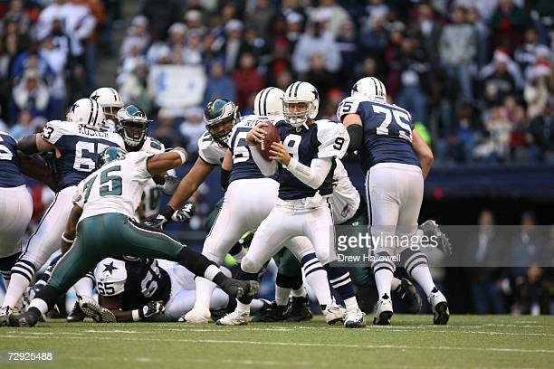 Quarterback Tony Romo of the Dallas Cowboys avoids a tackle during the game against the Philadelphia Eagles on December 25 2006 at Texas Stadium in...
