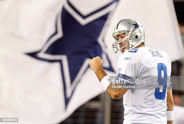 Quarterback Tony Romo of the Dallas Cowboys celebrates a touchdown by Felix Jones against the Philadelphia Eagles at Cowboys Stadium on January 3...