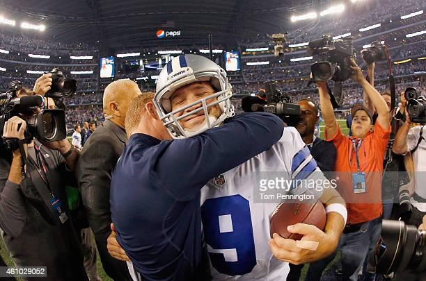 Quarterback Tony Romo of the Dallas Cowboys celebrates with head coach Jason Garrett of the Dallas Cowboys after the Cowboys beat the Detroit Lions...