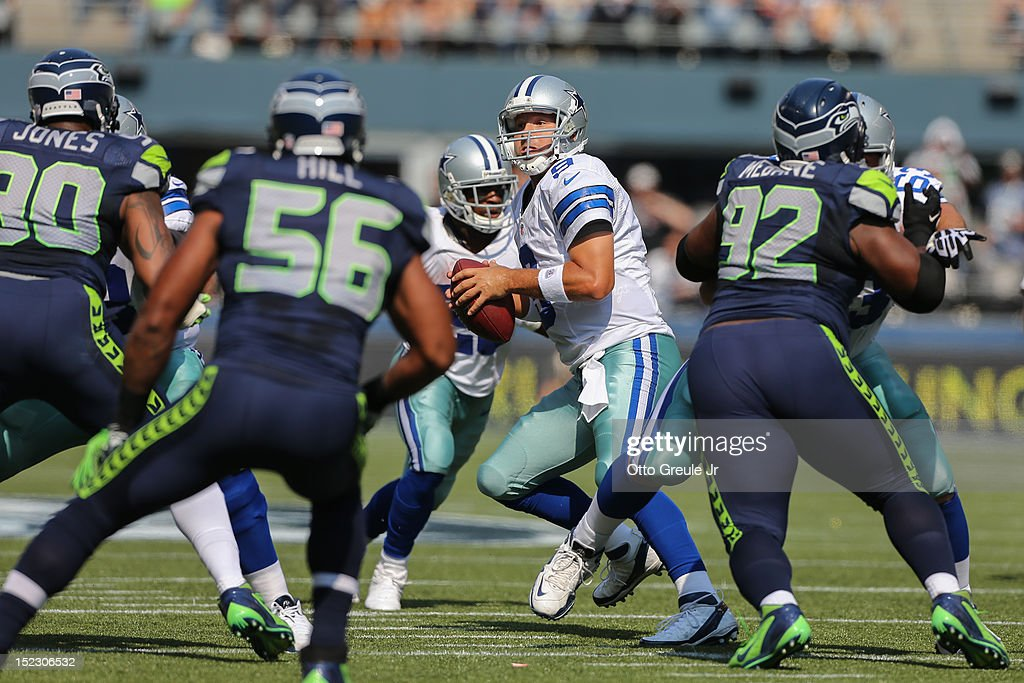 Quarterback <a gi-track='captionPersonalityLinkClicked' href=/galleries/search?phrase=Tony+Romo&family=editorial&specificpeople=756503 ng-click='$event.stopPropagation()'>Tony Romo</a> #9 of the Dallas Cowboys drops back to pass against the Seattle Seahawks at CenturyLink Field on September 16, 2012 in Seattle, Washington.