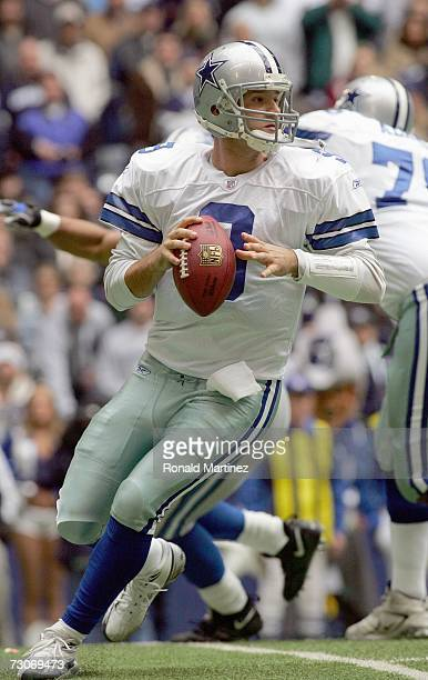 Quarterback Tony Romo of the Dallas Cowboys drops back to pass the ball during the game against the Detroit Lions at Texas Stadium on December 31...