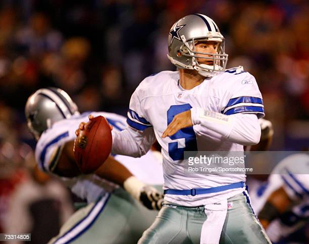 Quarterback Tony Romo of the Dallas Cowboys drops back to pass against the New York Giants at Giants Stadium on December 3 2006 in East Rutherford...