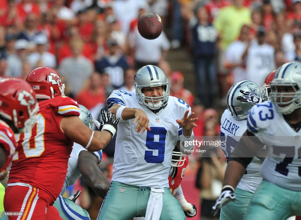 Quarterback <a gi-track='captionPersonalityLinkClicked' href=/galleries/search?phrase=Tony+Romo&family=editorial&specificpeople=756503 ng-click='$event.stopPropagation()'>Tony Romo</a> #9 of the Dallas Cowboys hurries his throw against pressure from defensive end Mike DeVito #70 of the Kansas City Chiefs during the first half on September 15, 2013 at Arrowhead Stadium in Kansas City, Missouri. Kansas City defeated Dallas 17-16.