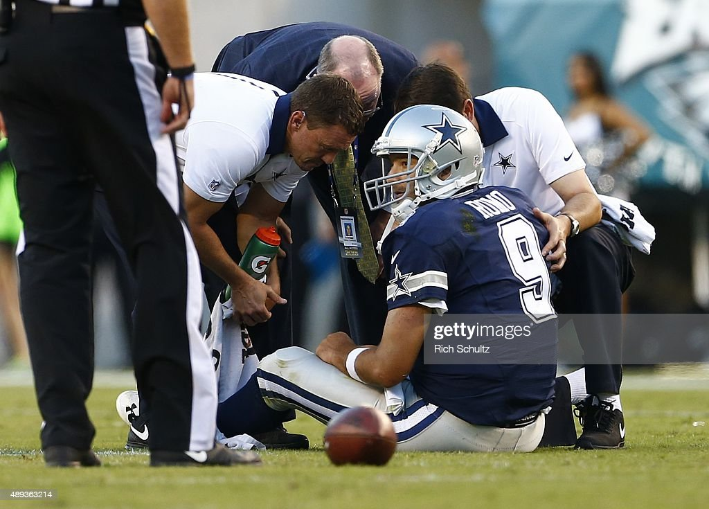 Quarterback Tony Romo of the Dallas Cowboys is looked at by medical personal after being injured on a sack against the Philadelphia Eagles during the...