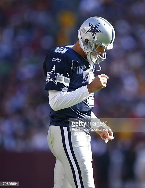Quarterback Tony Romo of the Dallas Cowboys looks on against the Washington Redskins on November 5 2006 at FedEx Field in Landover Maryland The...
