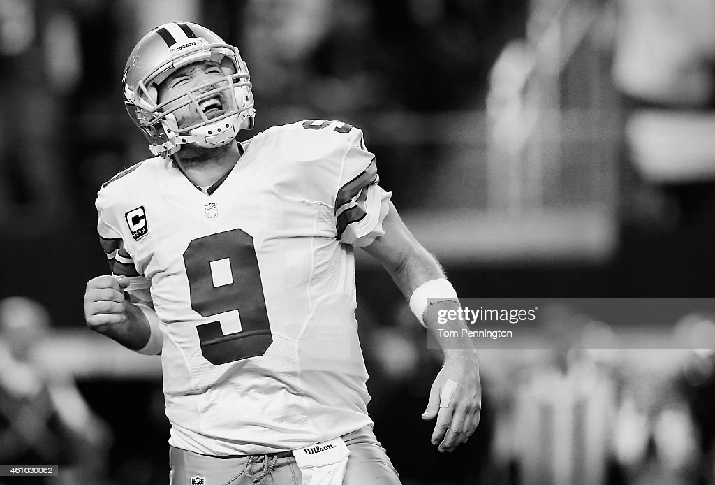 Quarterback Tony Romo of the Dallas Cowboys reacts after the Cowboys score against the Detroit Lions in the second half during a NFC Wild Card...