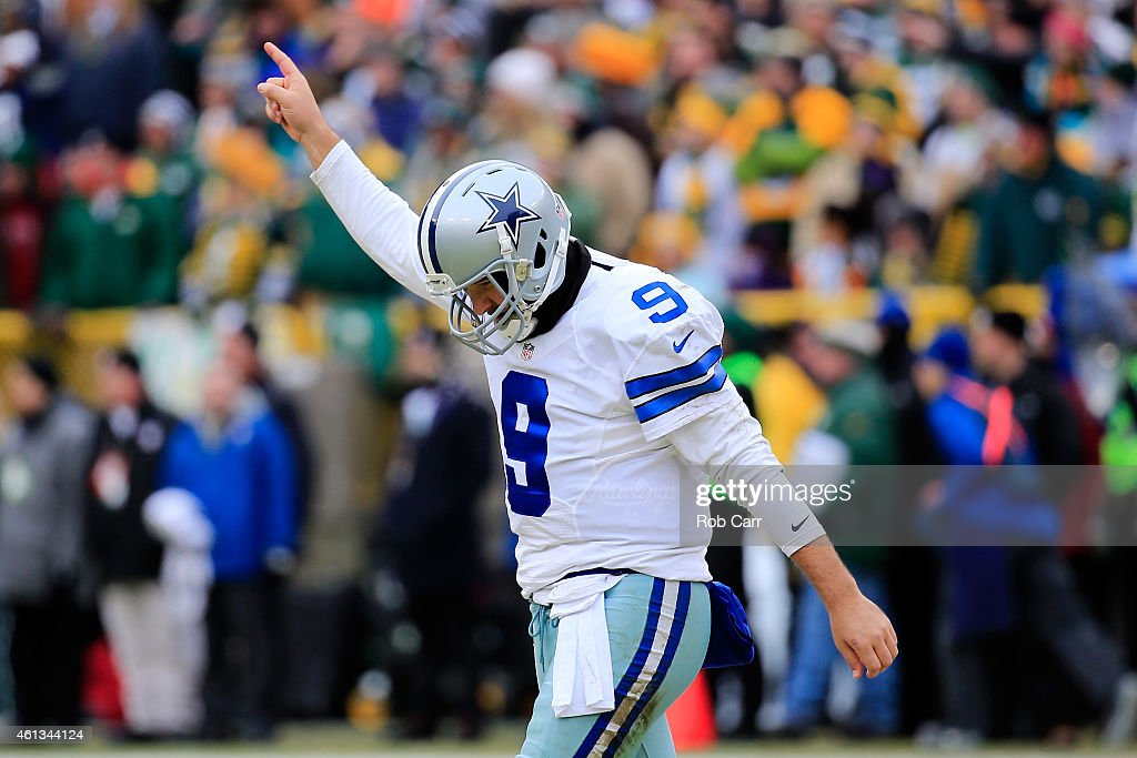 Quarterback Tony Romo of the Dallas Cowboys reacts after the Cowboys scored against the Green Bay Packers in the second qaurter of the 2015 NFC...